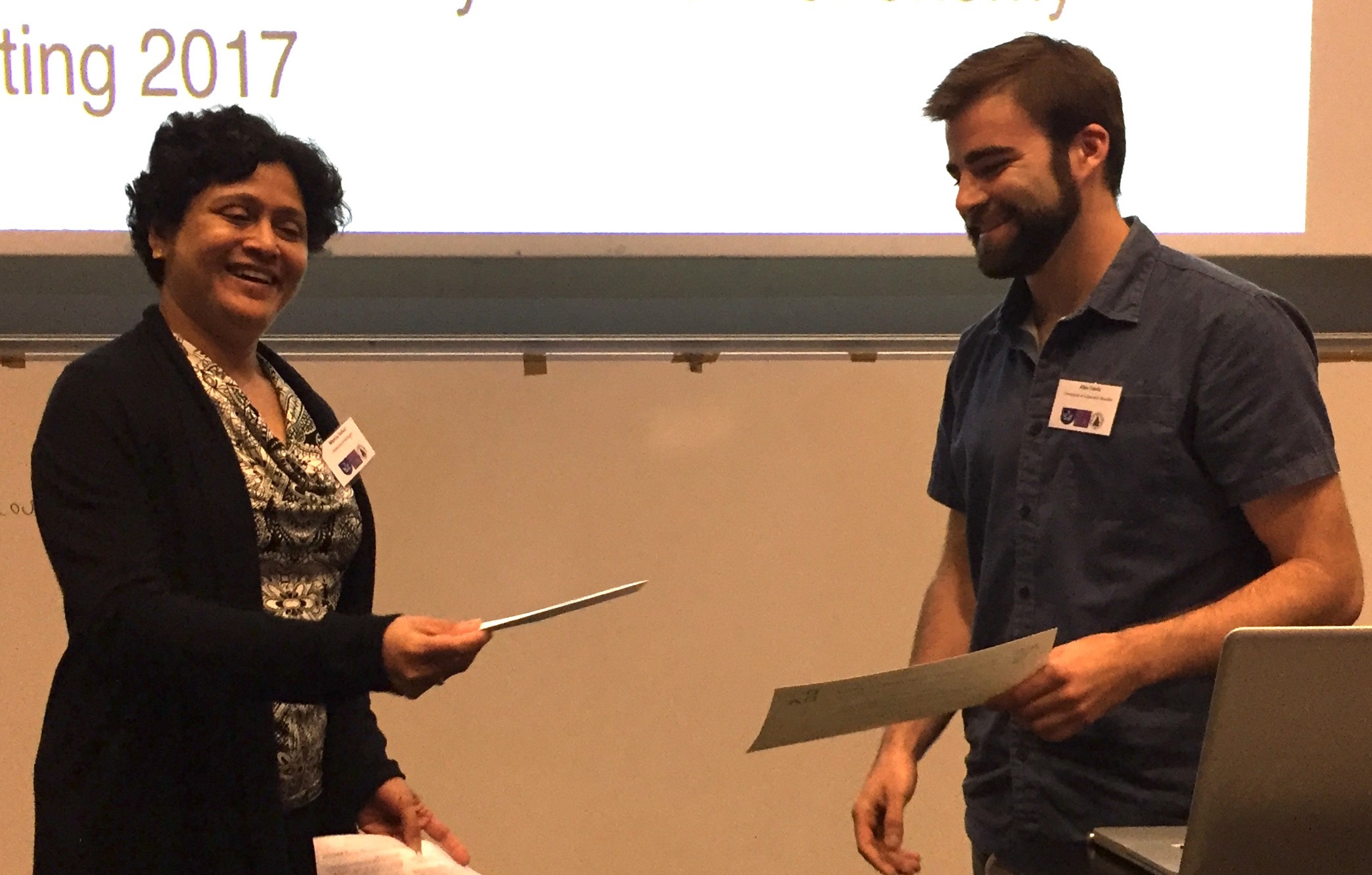 Alex Davis receives his award from DDA Chair Monica Valluri